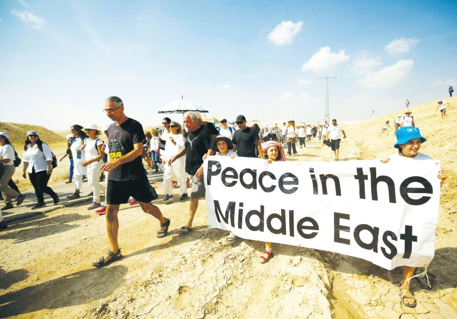 Demonstrators including Israeli and Palestinian activists take part in a demonstration in support of peace near Jericho last year. Credit: Reuters