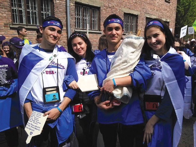STUDENTS FROM a Boca Raton high school take part – along with the restored Torah scroll – in the March of the Living in Auschwitz earlier this year. (Courtesy)