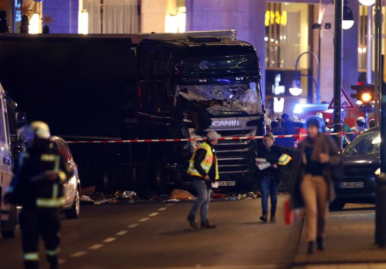 A truck plowed through a Christmas market in Berlin, killing multiple people and injuring more. (Reuters)