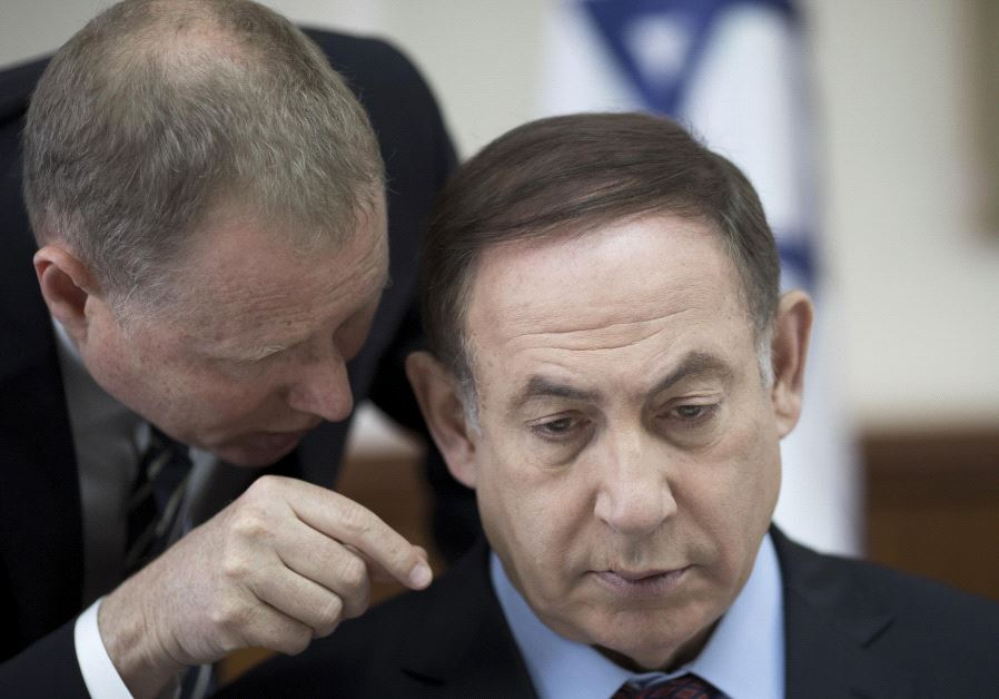 A darker hairdo for Israel's Prime Minister. (Abir Sultan/AFP)