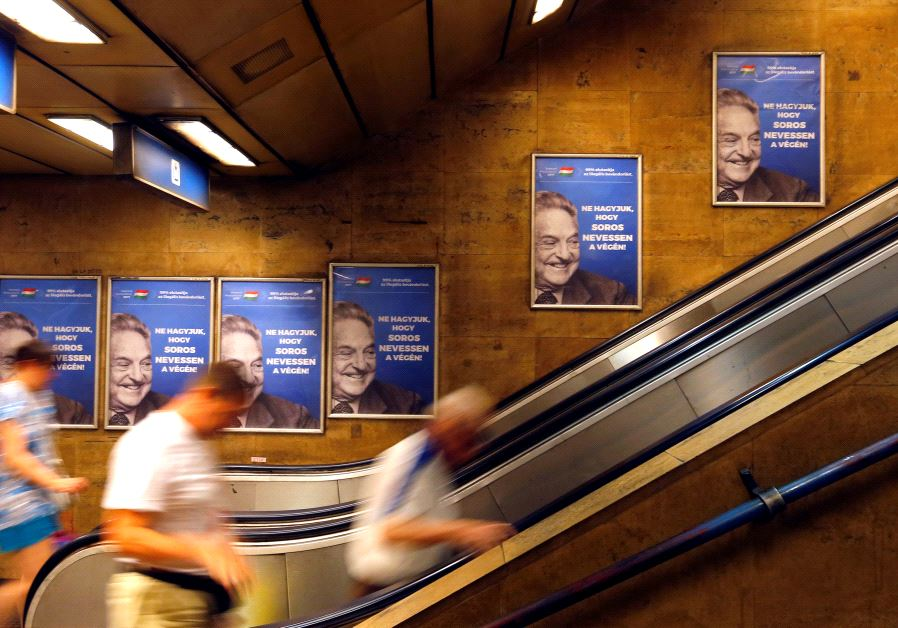 "Hungarian government poster portraying financier George Soros and saying ""Don't let George Soros have the last laugh"" is seen at an underground stop in Budapest, Hungary July 11, 2017. (REUTERS/LASZLO BALOGH)"