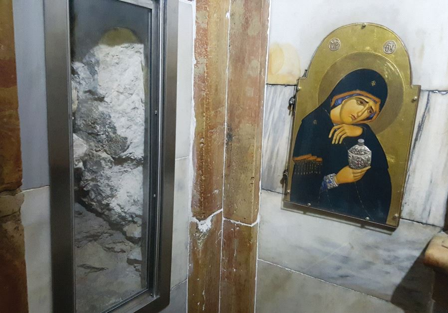 A window cut into the interior of the Aedicule exposes the bedrock of Jesus's tomb. (Ben Fisher)