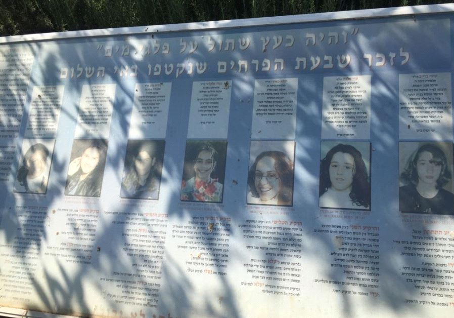 "Memorial plaque depicting the victims of the 1997 ""Island of Peace"" massacre (Credit: SETH J. FRANTZMAN)"