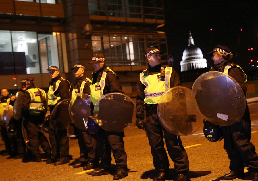 Police officers guard the approach to Southwark Bridge after an attack near London Bridge in London. (Reuters/Neil Hall)