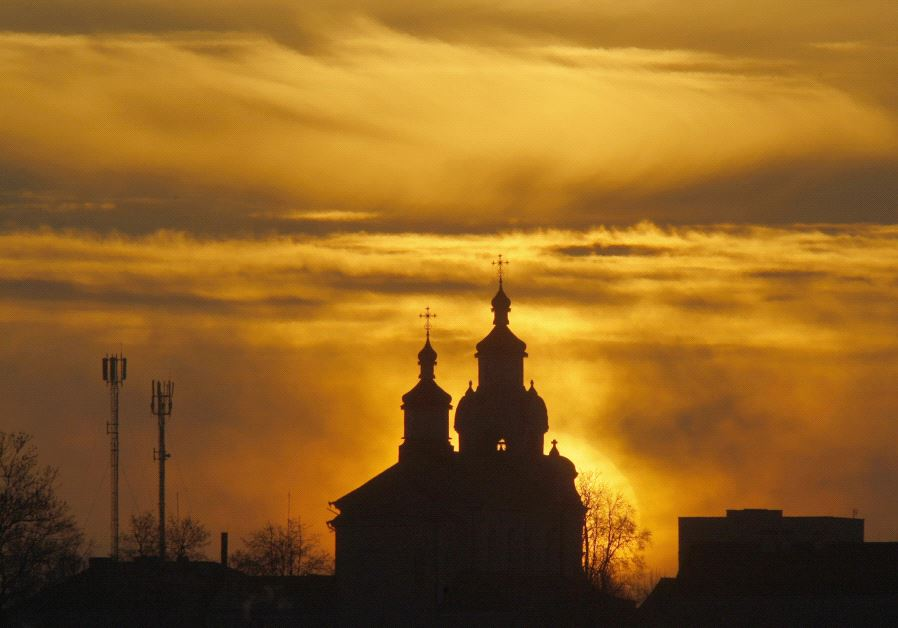 The sun rises above an Orthodox Church in the town of Novogrudok (Reuters/Vladimir Nikolsky)