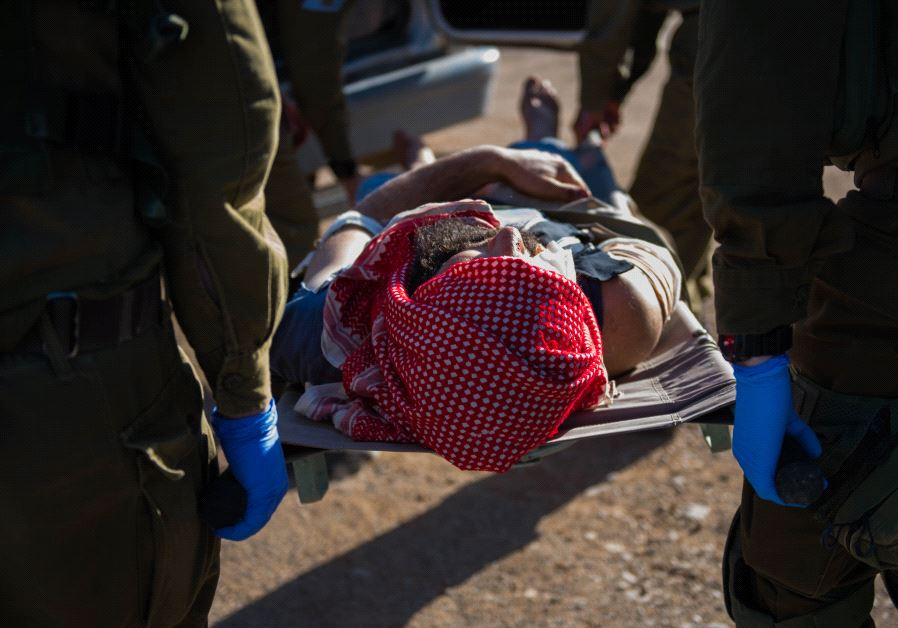 Israeli troops provide medical aid to a wounded Syrian (Credit: IDF)