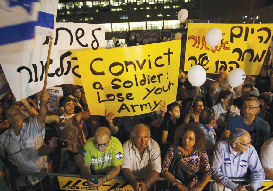SUPPORTERS OF Elor Azaria  take part in a protest. (Reuters)