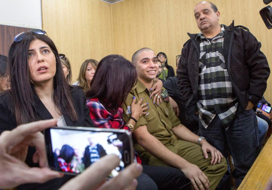 Elor Azaria is embraced by his mother as his father stands nearby, at the start of is sentencing hearing at a military court in Tel Aviv, Israel February 21, 2017 (Reuters)