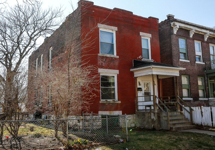 The residence of Juan M Thompson is seen after it was searched by police in connection with his arrest on charges of bomb threats made against Jewish organizations across the United States, in St. Louis, Missouri, U.S. March 3, 2017. (REUTERS/Lawrence Bryant)