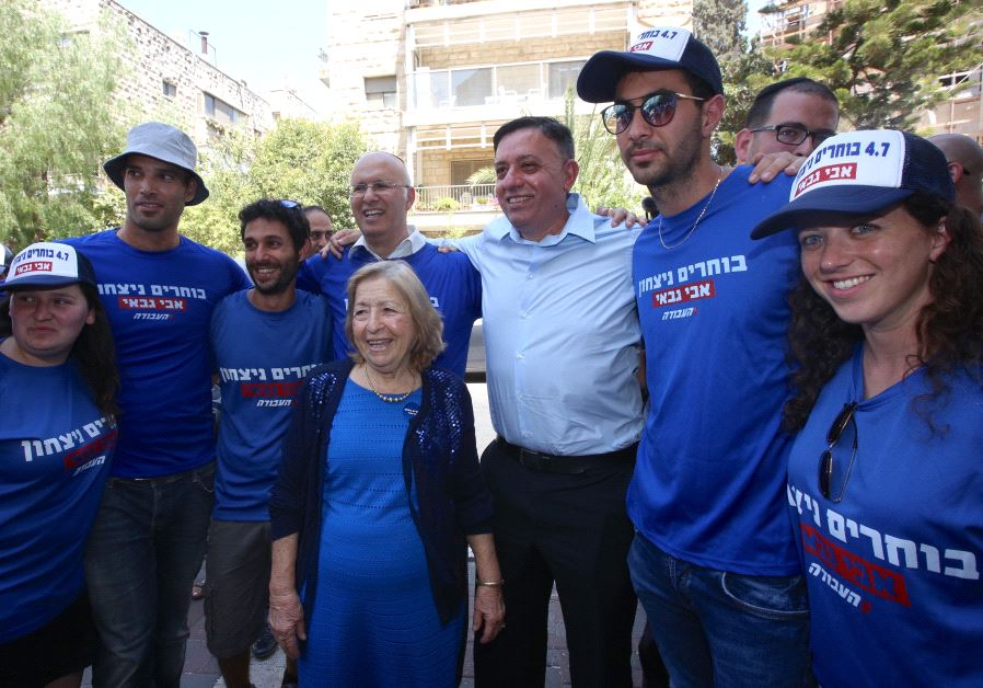 Avi Gabbay accompanied by his mother Sara and supporters at the Labor primary election, July 4 2017. ( MARC ISRAEL SELLEM/THE JERUSALEM POST )