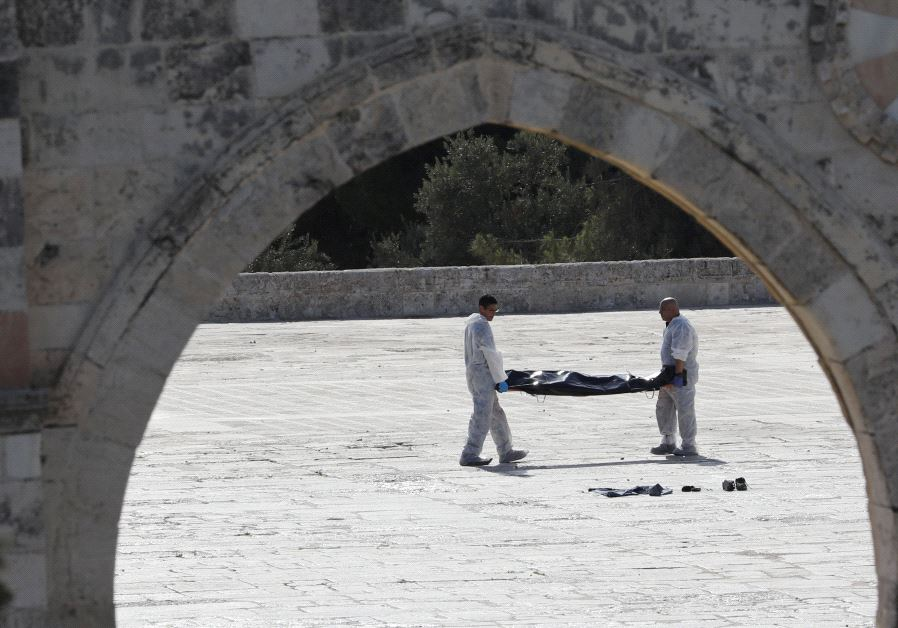 Israeli police remove body of one assailant from the Temple Mount compound (Reuters)