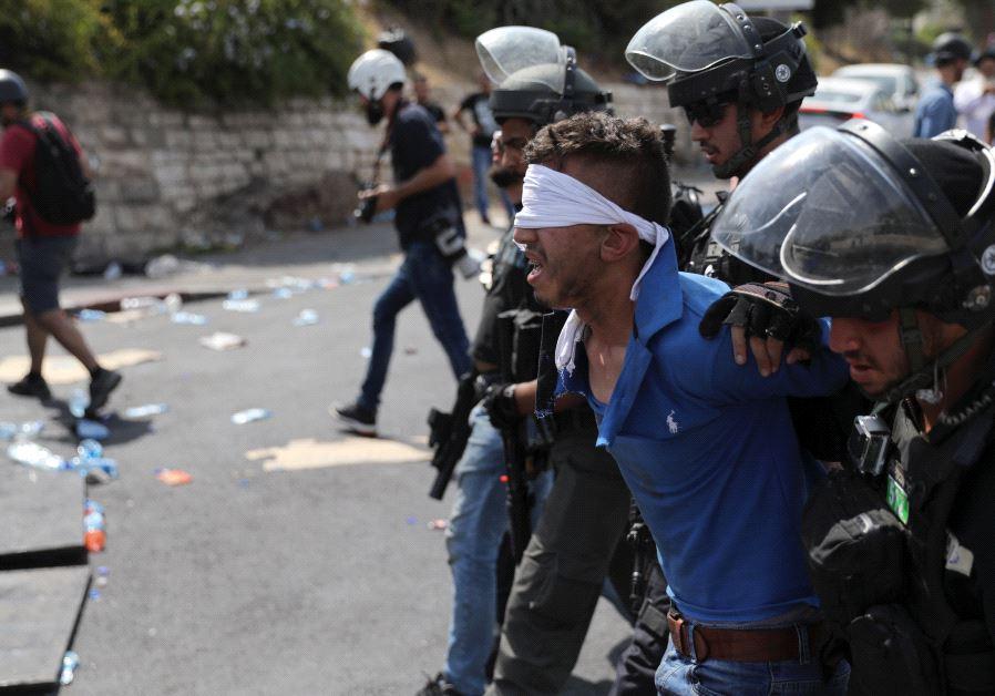Israeli security arrests Palestinian man  (Reuters)