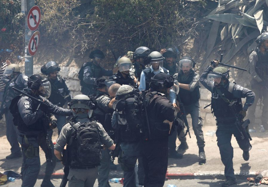 Israeli police detains a Palestinian (Reuters)