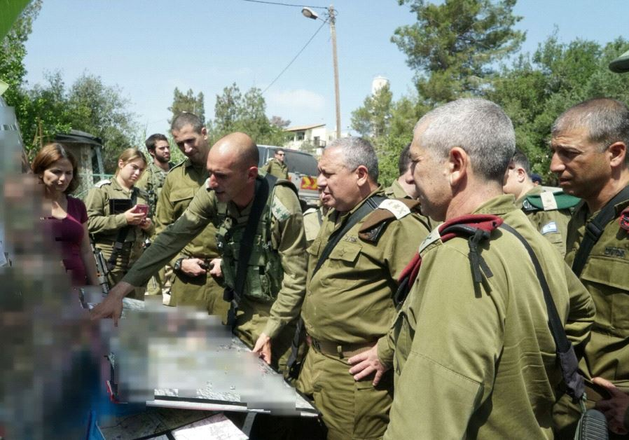 IDF Chief of Staff Lt.-Gen. Gadi Eisenkot is briefed by senior IDF officers at the scene of the attack in Halamish, July 22, 2017. (IDF Spokesperson's Unit)