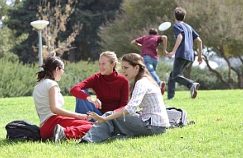 students on grass 298.88 (photo credit: Ariel Jerozolimski [file])