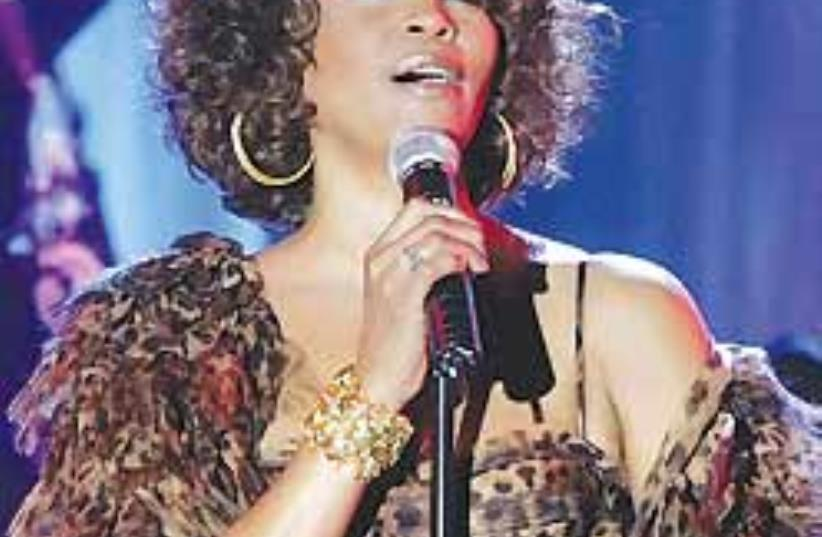 Whitney Houston says she wants to inspire people a (photo credit: AP)