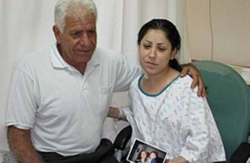 Magda Ouda visits Miriam Marviz, 26, who received  (photo credit: Courtesy Rabin Medical Center-Beilinson Campus)