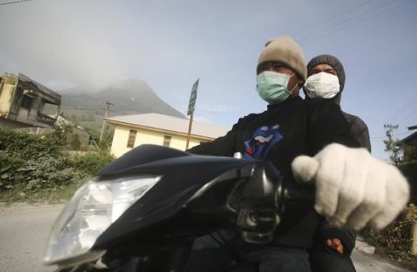 Indonesian villagers fleeing the erupting Mt. Sinabung.