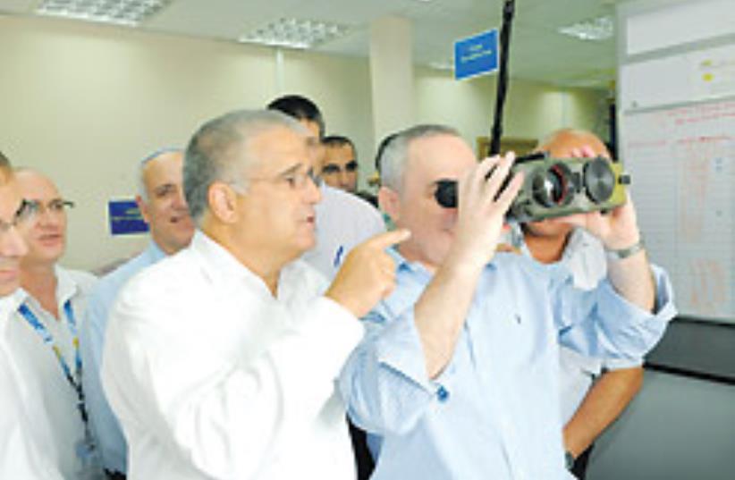 Finance Minister Yuval Steinitz looks through nigh (photo credit: Finance Ministry)