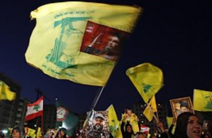 Hizbullah supporters wave Hizbullah flags during a (photo credit: AP)