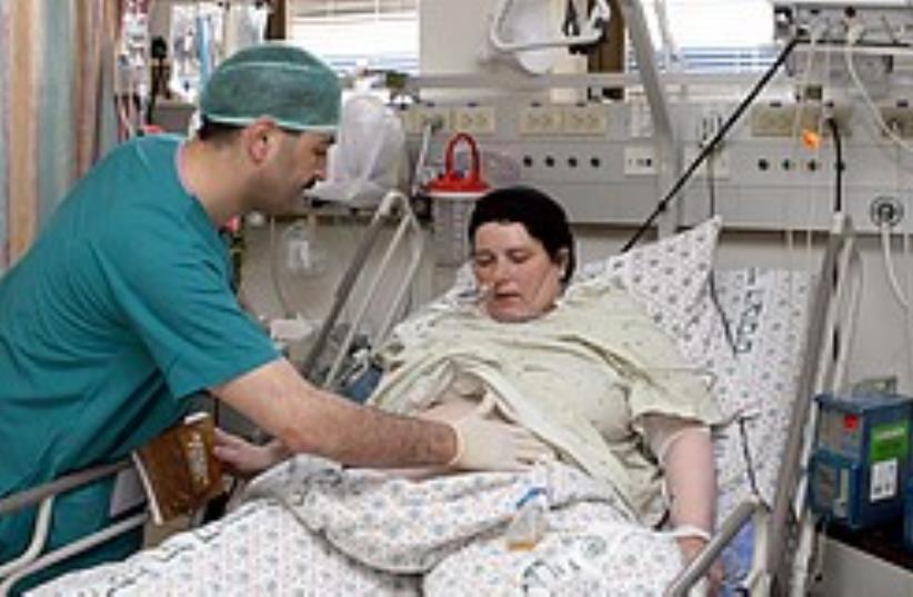 A doctor treats a patient at an Israeli hospital. (photo credit: Ariel Jerozolimksi)