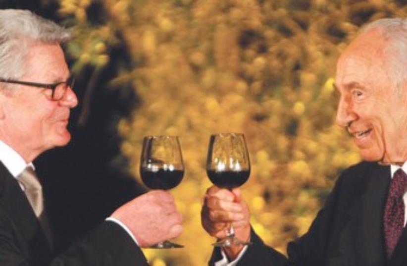 Presidents Joachim Gauck, Shimon Peres toast 370 (photo credit: Miriam Alster/Flash 90)