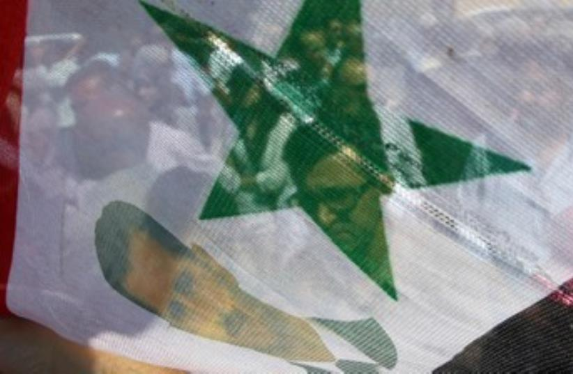 Assad supporters Amman 370 (photo credit: Reuters)