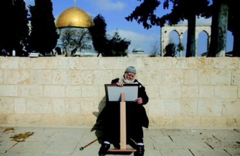 Un palestinien lit un Coran devant le Dome du Rocher (photo credit: REUTERS)