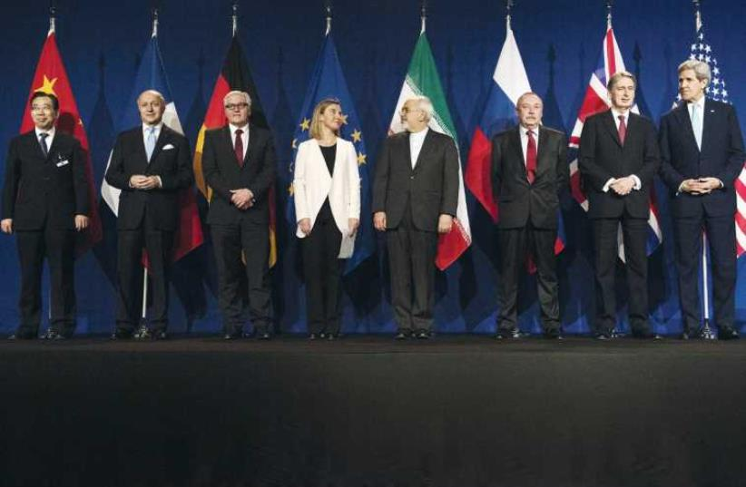 The P5+1 – China, France, Germany, the US, the UK and Russia – prepare to meet with Iranian Foreign Minister Javad Zarif at nuclear talks in Lausanne. (photo credit: REUTERS)