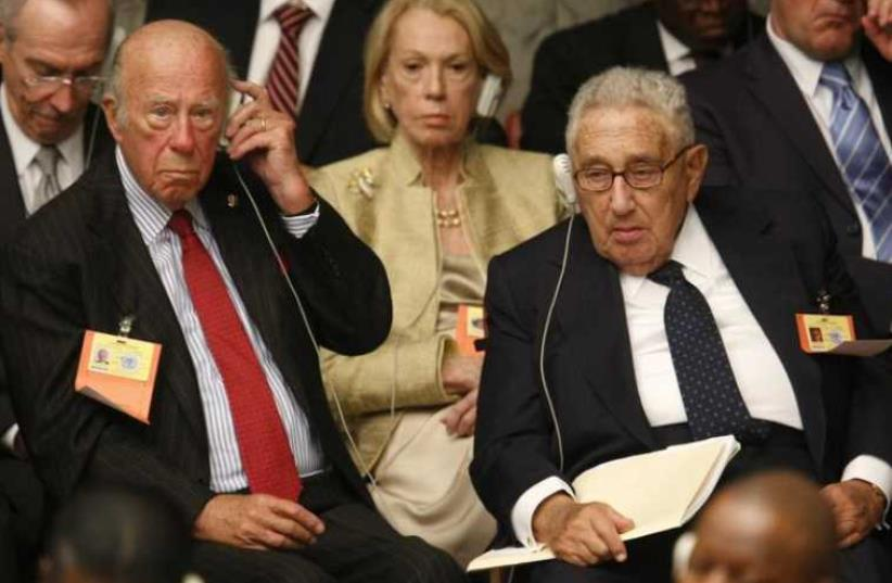 Former US Secretaries of State Henry Kissinger (R) and George Shultz attend a Security Council Summit meeting during the United Nations General Assembly at UN headquarters in New York (photo credit: REUTERS)