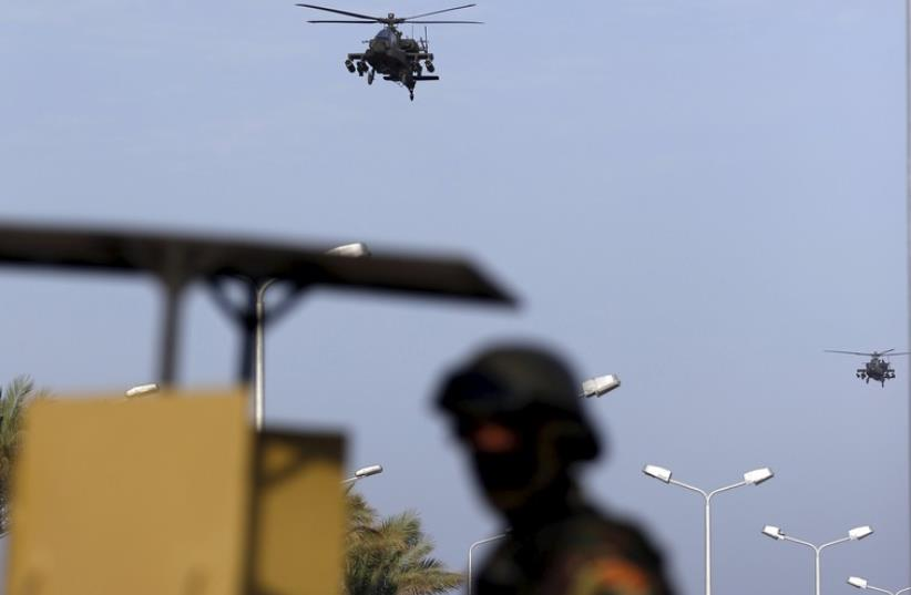 Egyptian military helicopters fly over a republican guard around the congress hall during the Arab Summit in Sharm el-Sheikh, in the South Sinai governorate, south of Cairo, March 28 (photo credit: REUTERS)