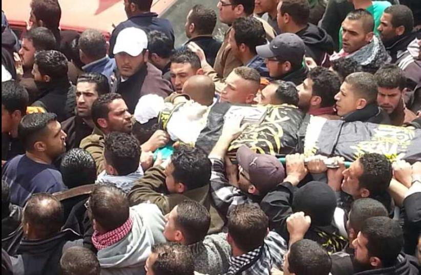 Palestinians take part in a West Bank funeral procession for an Islamic Jihad man who died after his release from an Israeli prison (photo credit: MAAN NEWS AGENCY)