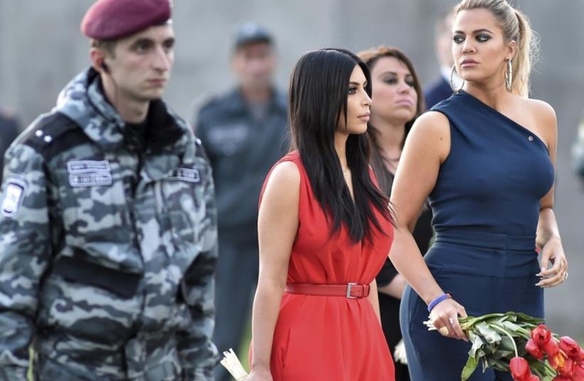 Kardashian sisters Kim and Khloe at Armenian Genocide Memorial (photo credit: REUTERS)