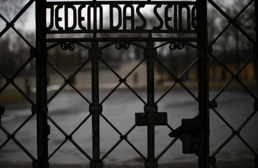 """The camp gate with the inscription """"to give each his due"""" is pictured at former concentration camp Buchenwald near Weimar  (photo credit: REUTERS)"""