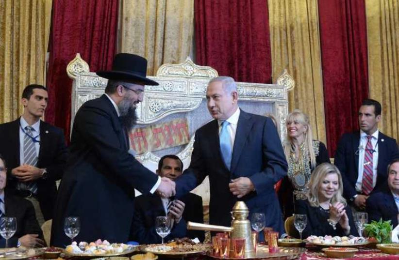 Prime Minister Benjamin Netanyahu and his wife Sara at a Mimouna celebration in Or Akiva (photo credit: KOBY GIDEON/GPO)