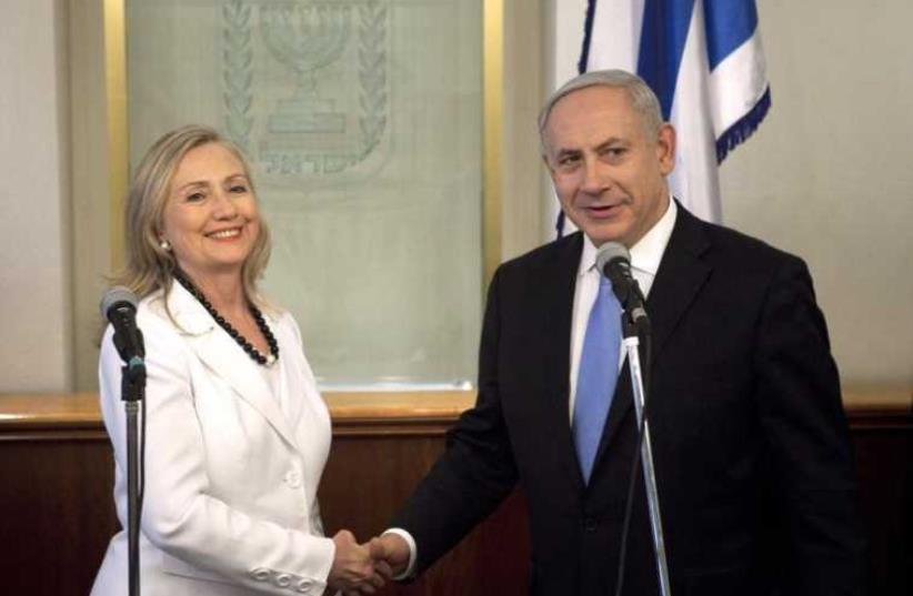 Prime Minister Benjamin Netanyahu (R) and then-Secretary of State Hillary Clinton shake hands during their meeting in Jerusalem in 2012 (photo credit: REUTERS)