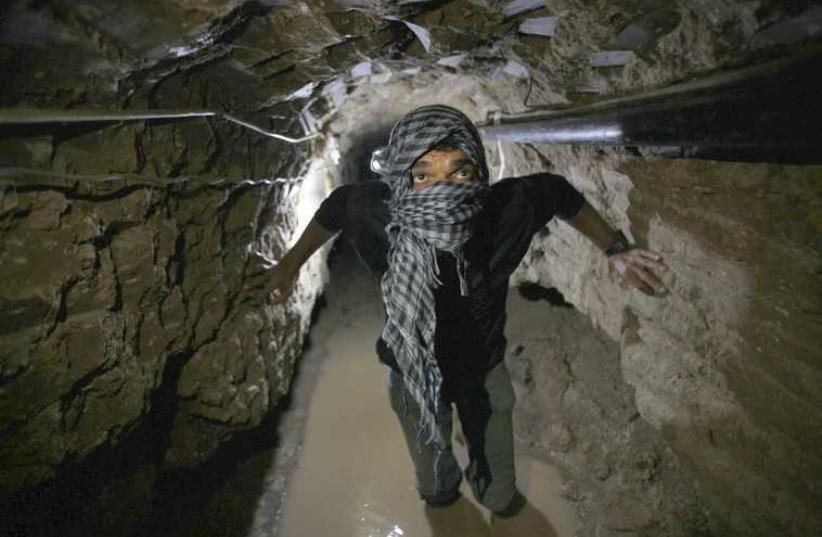 A smuggling tunnel beneath the Egyptian-Gaza border in Rafah [File] (photo credit: REUTERS)
