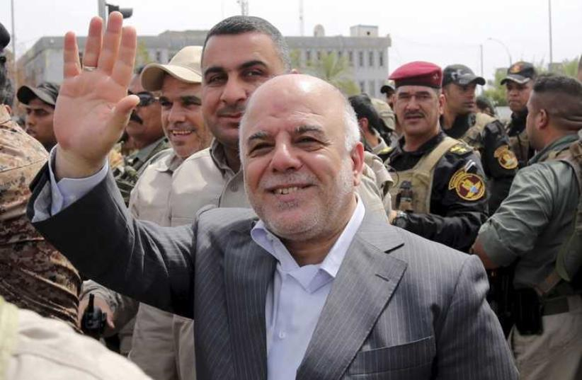 Iraqi Pm Haidar al-Abadi visists government forces (photo credit: REUTERS)