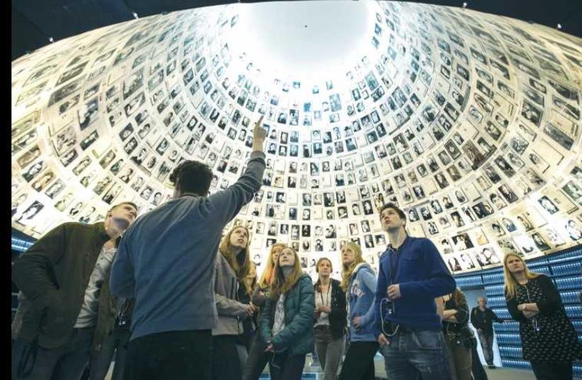 STUDENTS FROM Germany visit the Hall of Names at Yad Vashem in Jerusalem (photo credit: REUTERS)