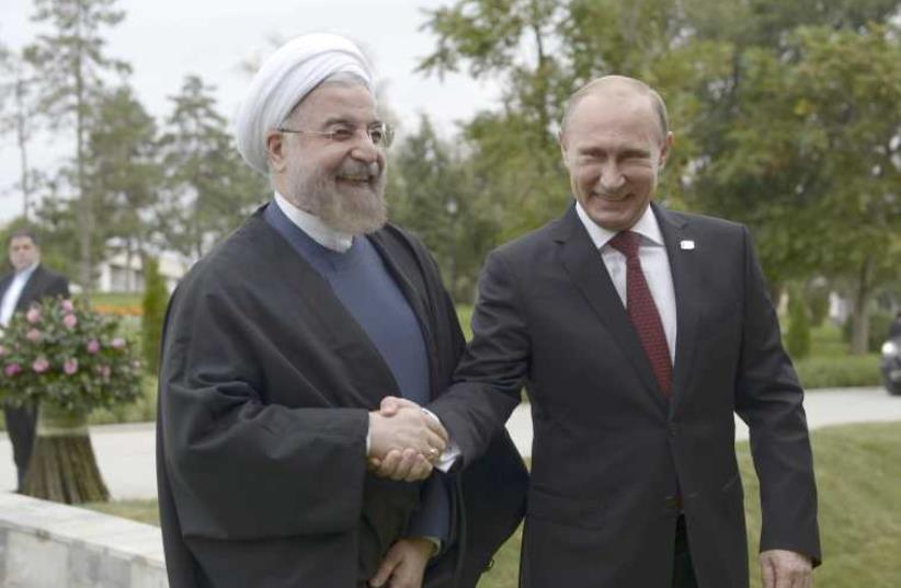 Iranian President Hassan Rouhani and Russian President Vladimir Putin (photo credit: REUTERS)