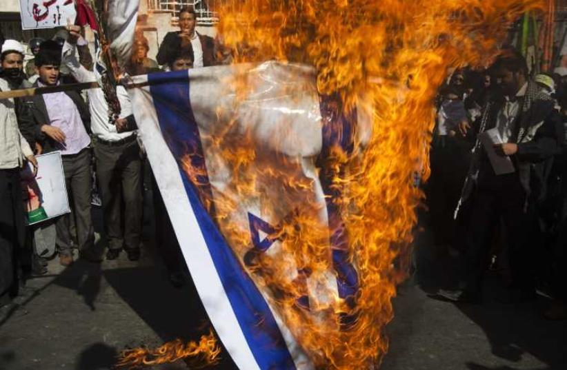 Iranian students burn Israeli flag. (photo credit: REUTERS)