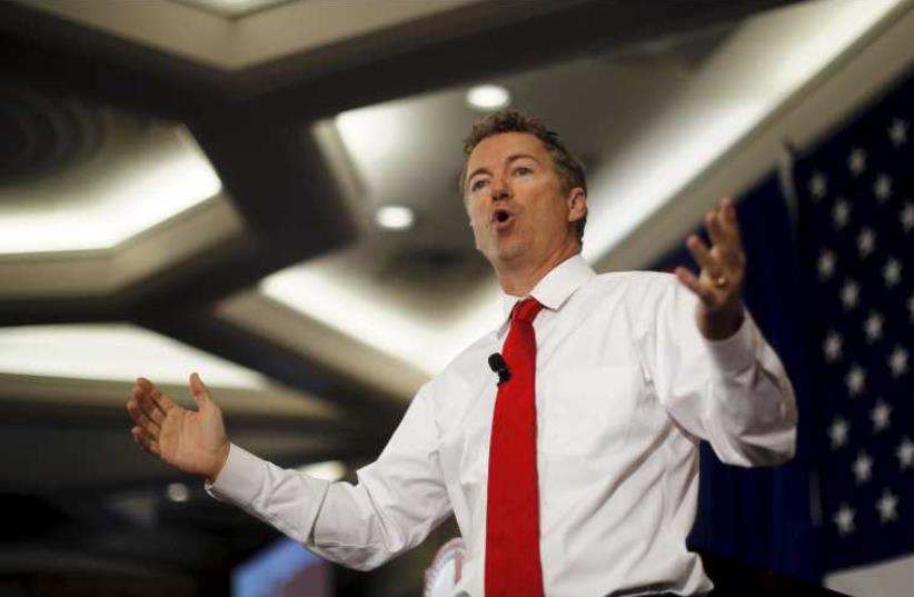 Republican presidential candidate US Senator Rand Paul (R-KY) speaks at the First in the Nation Republican Leadership Conference in New Hampshire April 18 (photo credit: REUTERS)
