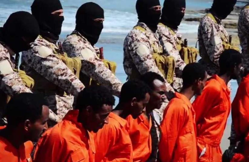 Screenshot from video of ISIS terrorists purportedly killing Ethiopian Christians in Libya (photo credit: screenshot)