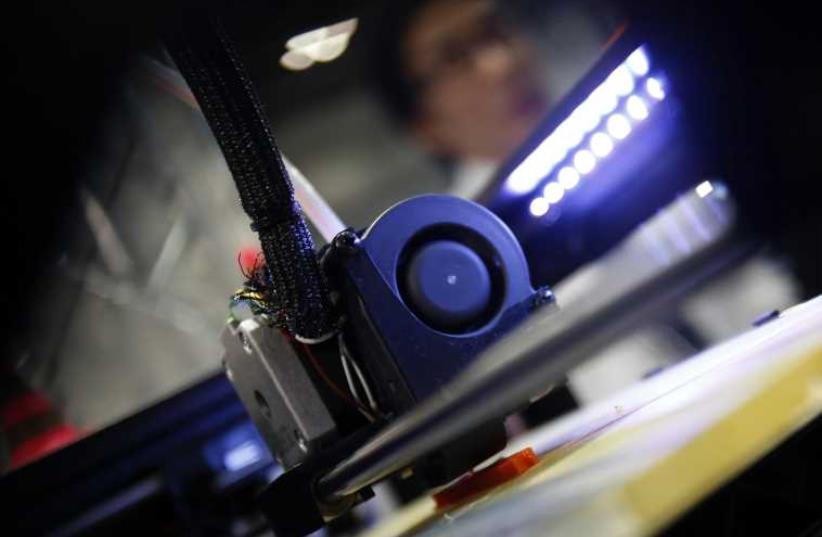 3D printer at work (stock)  (photo credit: REUTERS)