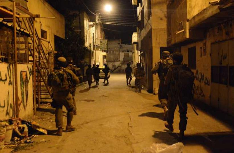 IDF troops operating in the West Bank (photo credit: IDF SPOKESMAN'S UNIT)