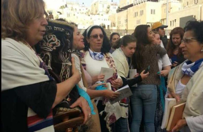 Women of the Wall carry a Torah scroll into the women's section of the Western Wall plaza (photo credit: WOMEN OF THE WALL)