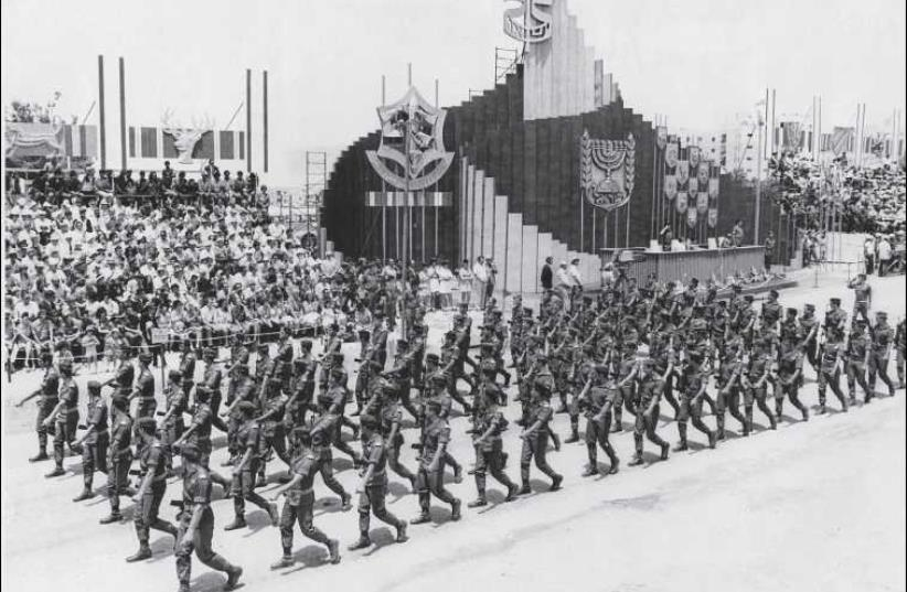 IDF troops take part in a military parade in Jerusalem for the 25th anniversary of Israel's independence in 1973. This was the final year such parades were held in Israel. (photo credit: UPI/JERUSALEM POST ARCHIVES)