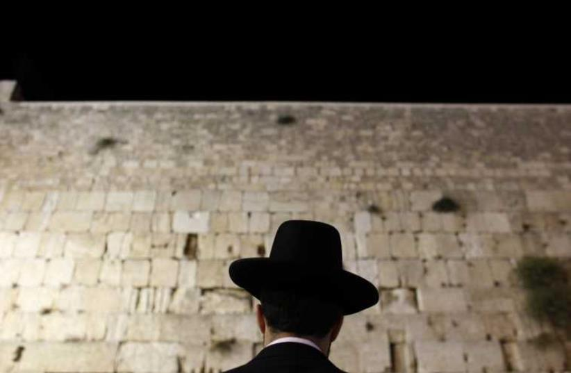 An Orthodox Jewish worshipper prays at the Western Wall, Judaism's holiest prayer site, in Jerusalem's Old City (photo credit: REUTERS)