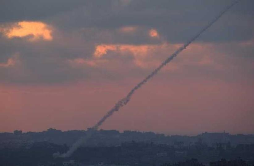 Smoke trails are seen as rockets are launched from the Gaza Strip towards Israel [File] (photo credit: REUTERS)