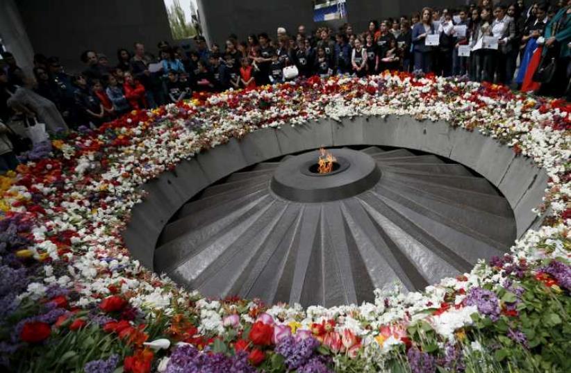 People mourn at the Tsitsernakaberd Armenian Genocide Memorial Museum in Yerevan (photo credit: REUTERS)